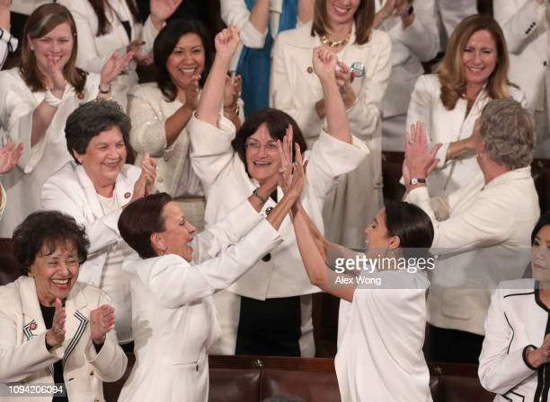 Rep Alexandria OcasioCortez and other female lawmakers cheer during President Donald Trump's State of the Union address in the chamber of the US...