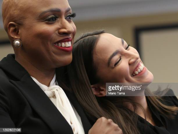 Rep Alexandria OcasioCortez and Rep Ayanna Pressley embrace at a news conference introducing the 'People's Housing Platform' on Capitol Hill on...