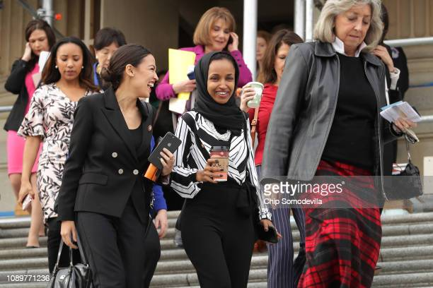 Rep Alexandria OcasioCortez and Rep Ilhan Omar join their fellow House Democratic women for a portrait in front of the US Capitol January 04 2019 in...