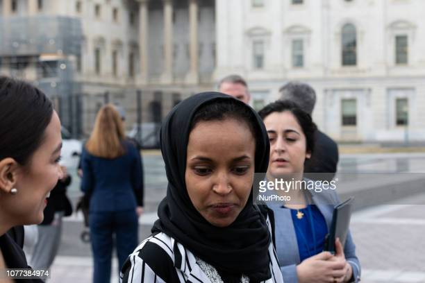 Rep Alexandria OcasioCortez and Rep Ilhan Omar make their way outside to take a group photo with Speaker Nancy Pelosi and fellow House Democratic...