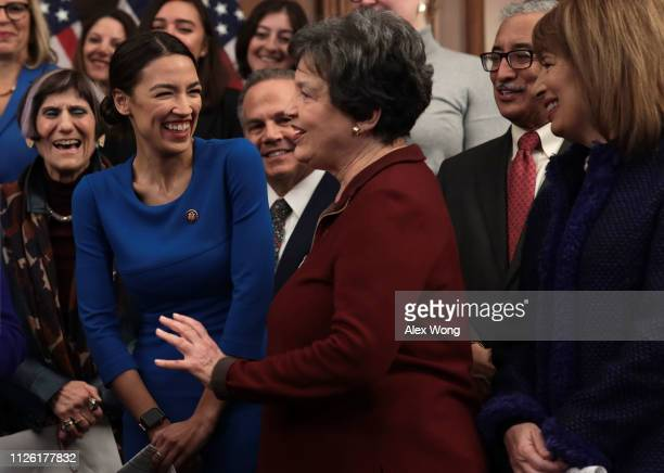 S Rep Alexandria OcasioCortez and Rep Lois Frankel share a moment as Rep Rosa DeLauro Rep Bobby Scott and Rep Jackie Speier look on during a news...