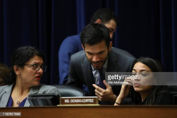 Rep. Alexandria Ocasio-Cortez and Rep. Rashida Tlaib confer with an aide while listening to testimony from acting Homeland Security Secretary Kevin...