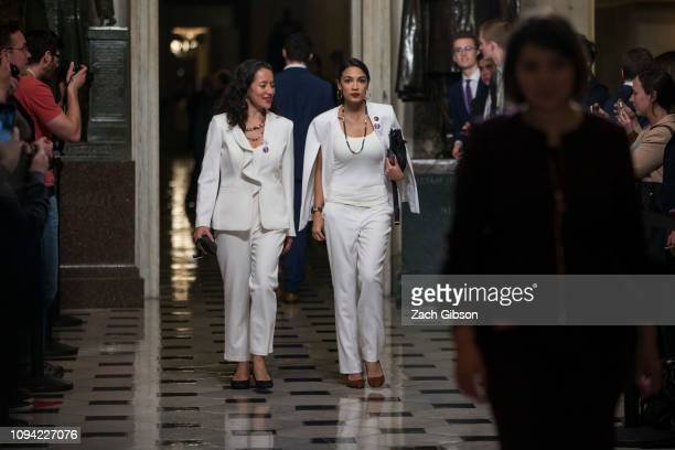 Rep Alexandria OcasioCortez arrives ahead of the State of the Union address in the chamber of the US House of Representatives at the US Capitol...