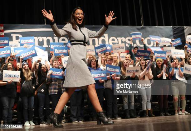 Rep Alexandria OcasioCortez arrives on stage at a campaign event for Democratic presidential candidate Sen Bernie Sanders at the Ames City Auditorium...