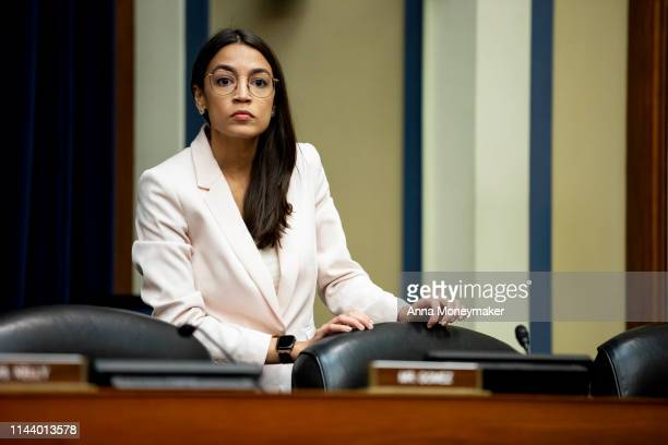 S Rep Alexandria OcasioCortez arrives to a House Civil Rights and Civil Liberties Subcommittee hearing on confronting white supremacy at the US...