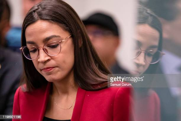 Rep Alexandria OcasioCortez attends a press conference with Rep Andy Levin about their new bill called the EV Freedom Act on Capitol Hill on February...