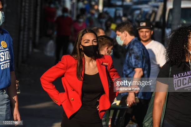 Rep. Alexandria Ocasio-Cortez campaigns on June 23, 2020 in the Bronx borough of New York City. Ocasio-Cortez is running for re-election in the 14th...
