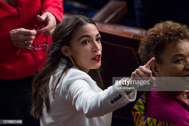 Rep Alexandria OcasioCortez DNY is seen in the Capitol's House chamber before members were sworn in on the first day of the 116th Congress on January...