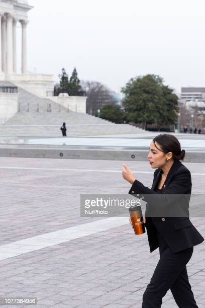 Rep Alexandria OcasioCortez heads inside the US Capitol after taking a group photo with Speaker Nancy Pelosi and fellow House Democratic women in...