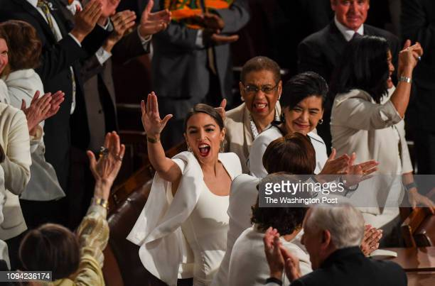Rep Alexandria OcasioCortez highfives other congresswomen after President Donald J Trump acknowledged newly elected female members of congress during...