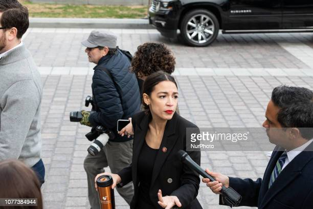 Rep Alexandria OcasioCortez is interviewd by a reporter after taking a group photo with Speaker Nancy Pelosi and fellow House Democratic women in...