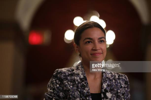 S Rep Alexandria OcasioCortez is interviewed for TV June 27 2019 at the US Capitol in Washington DC Speaker Rep Nancy Pelosi has backed down and will...