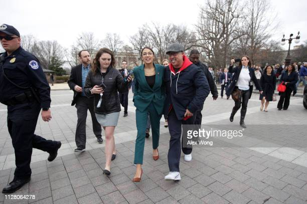 S Rep Alexandria OcasioCortez leaves after a news conference in front of the US Capitol February 7 2019 in Washington DC Sen Markey and Rep...