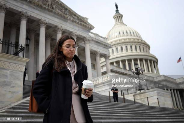 Rep Alexandria OcasioCortez leaves the US Capitol after passage of the stimulus bill known as the CARES Act on March 27 2020 in Washington DC The...