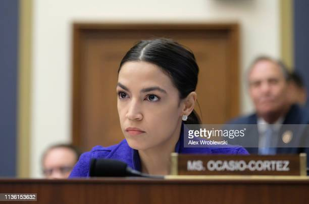 Rep Alexandria OcasioCortez listens during a House Financial Services Committee hearing on April 10 2019 in Washington DC Seven CEOs of the country's...