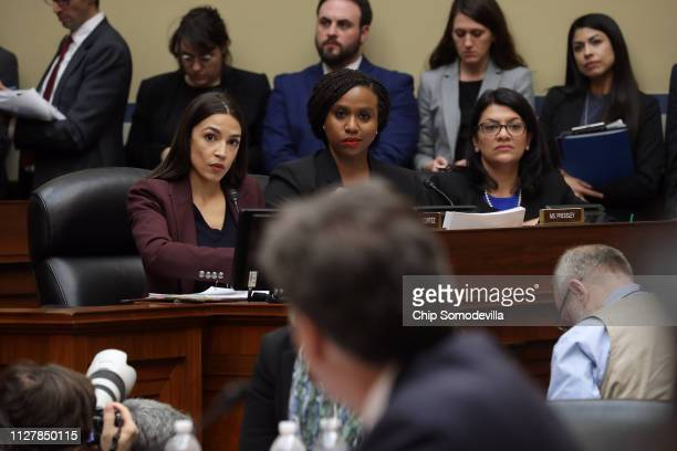 Rep Alexandria OcasioCortez Rep Ayanna Pressley and Rep Rashida Tlaib listen as Michael Cohen former attorney and fixer for President Donald Trump...
