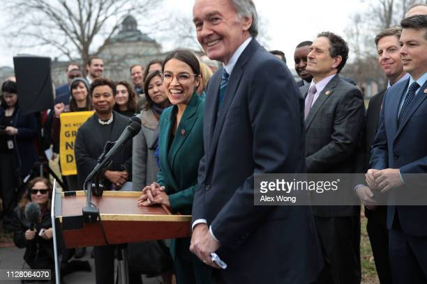 S Rep Alexandria OcasioCortez Sen Ed Markey and other Congressional Democrats listen during a news conference in front of the US Capitol February 7...