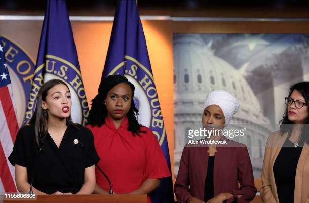 US Rep Alexandria OcasioCortez speaks as Reps Ayanna Pressley Ilhan Omar and Rashida Tlaib listen during a news conference at the US Capitol on July...