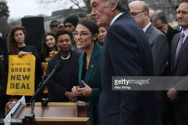 S Rep Alexandria OcasioCortez speaks as Sen Ed Markey and other Congressional Democrats listen during a news conference in front of the US Capitol...