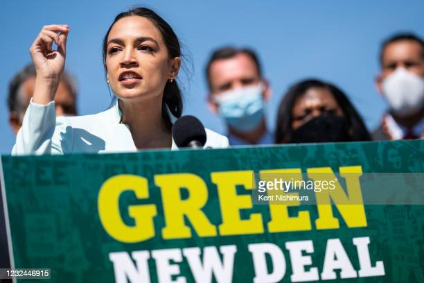 Rep. Alexandria Ocasio-Cortez speaks at a news conference to reintroduce the Green New Deal and introduce the Civilian Climate Corps Act at the...