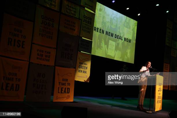 S Rep Alexandria OcasioCortez speaks during a rally at Howard University May 13 2019 in Washington DC The Sunrise Movement held an event for the...