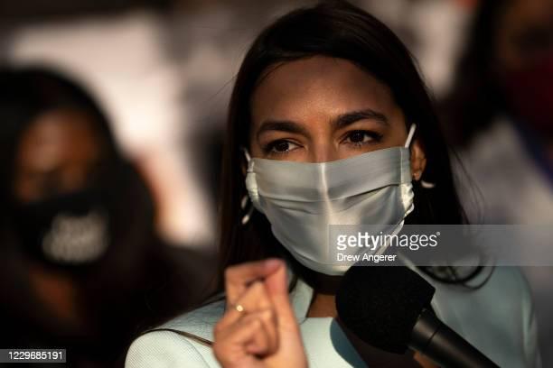 Rep. Alexandria Ocasio-Cortez speaks outside of the Democratic National Committee headquarters on November 19, 2020 in Washington, DC. Ocasio-Cortez...