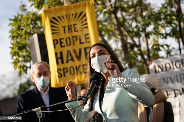 Rep. Alexandria Ocasio-Cortez speaks outside of the Democratic National Committee headquarters on November 19, 2020 in Washington, DC. Rep....