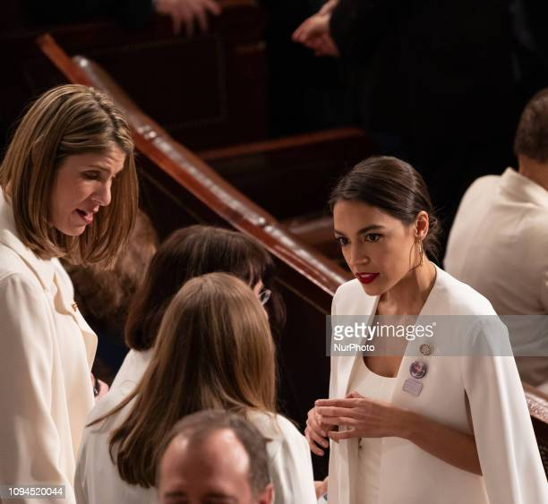 Rep Alexandria OcasioCortez speaks to a fellow member before US President Donald Trump's second State of the Union address to a joint session of...