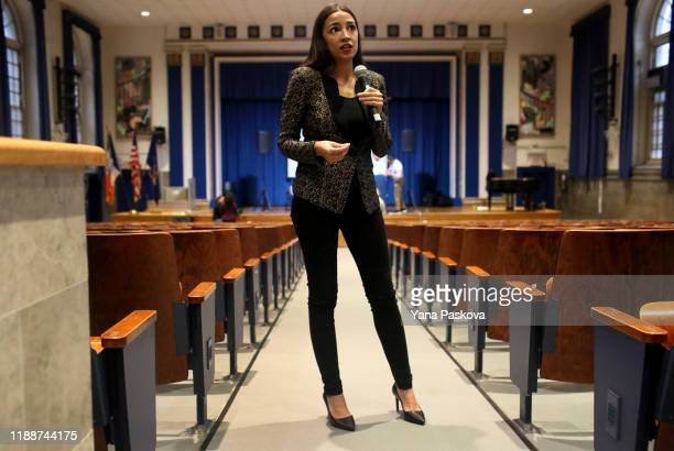 S Rep Alexandria OcasioCortez speaks with members of the media before a Green New Deal For Public Housing Town Hall on December 14 2019 in the Queens...