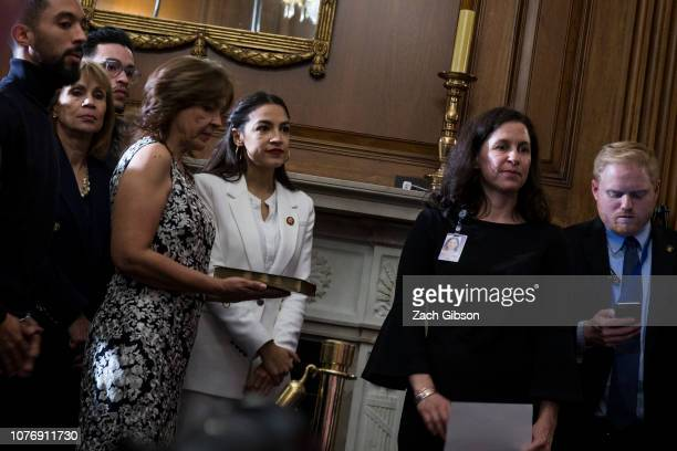 Rep Alexandria OcasioCortez stands in line during a ceremonial mock swearing in ceremony with House Speaker Nancy Pelosi on Capitol Hill on January 3...
