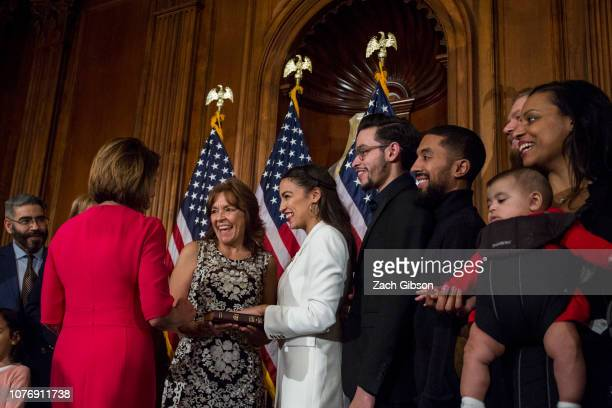 Rep Alexandria OcasioCortez takes part in a ceremonial mock swearing in ceremony with House Speaker Nancy Pelosi on Capitol Hill on January 3 2019 in...