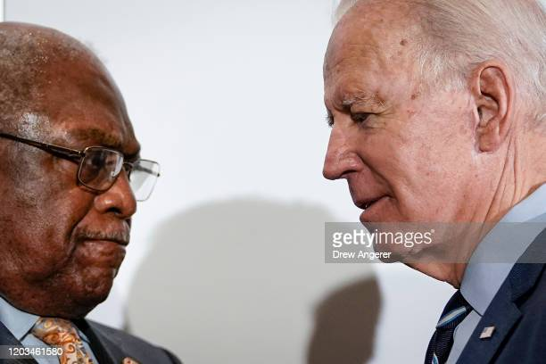 US Rep and House Majority Whip James Clyburn and Democratic presidential candidate former Vice President Joe Biden pauses speaks briefly with each...