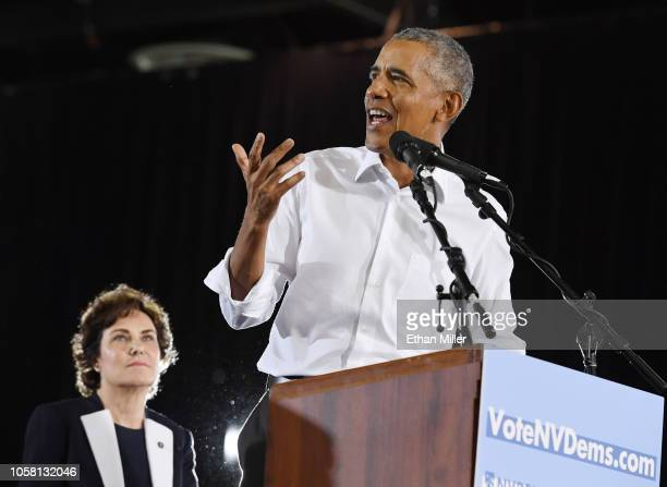 S Rep and US Senate candidate Jacky Rosen looks on as former US President Barack Obama speaks during a getoutthevote rally at the Cox Pavilion as he...