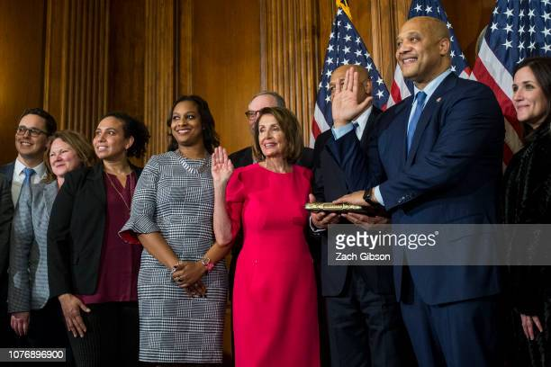 Rep André Carson takes part in a ceremonial swearing in ceremony with House Speaker Nancy Pelosi on January 3 2019 in Washington DC Under the cloud...