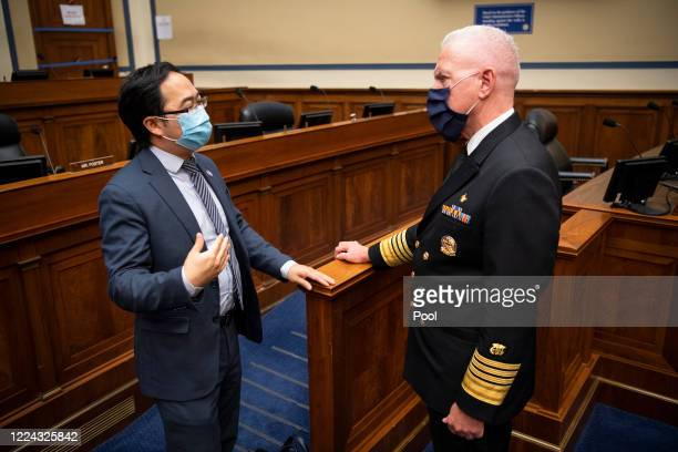 Rep Andy Kim DNJ left speaks with Admiral Brett P Giroir MD Assistant Secretary for Health at the conclusion of a House Oversight and Reform...