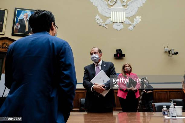 Rep. Andy Kim speaks with Health and Human Services Secretary Alex M. Azar at the conclusion of the House Select Subcommittee on the Coronavirus...