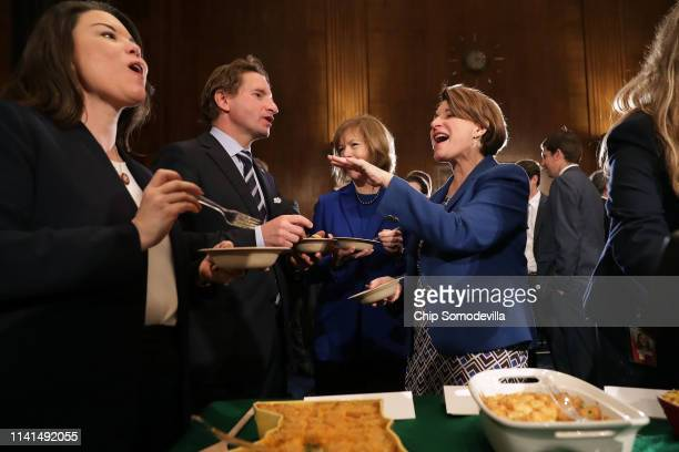 Rep Angie Craig Rep Dean Phillips Sen Tina Smith and Democratic presidential candidate Sen Amy Klobuchar sample some of the entries in the ninth...