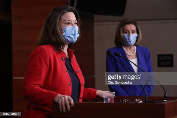 Rep. Angie Craig talks to reporters with Speaker of the House Nancy Pelosi during a news conference in the U.S. Capitol Visitors Center on March 19,...