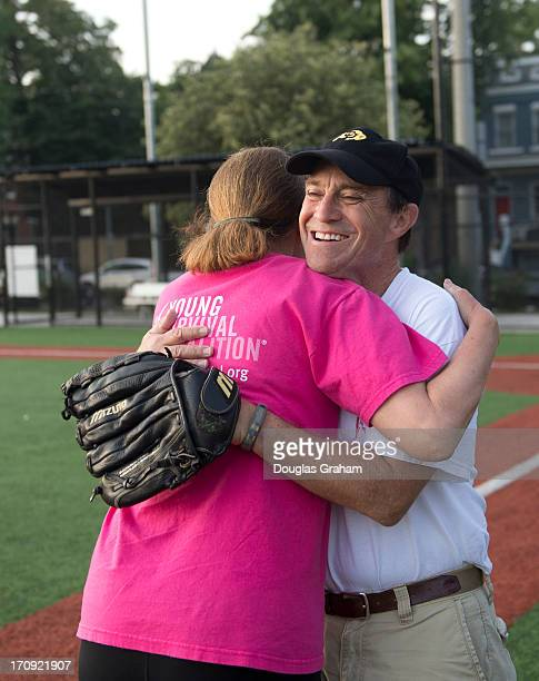 Rep Ann Kirkpatrick DAZ gives coach Rep Ed Perlmutter DCO a hug during the practice for the Congressional Womens Softball Game at Watkins Elementary...