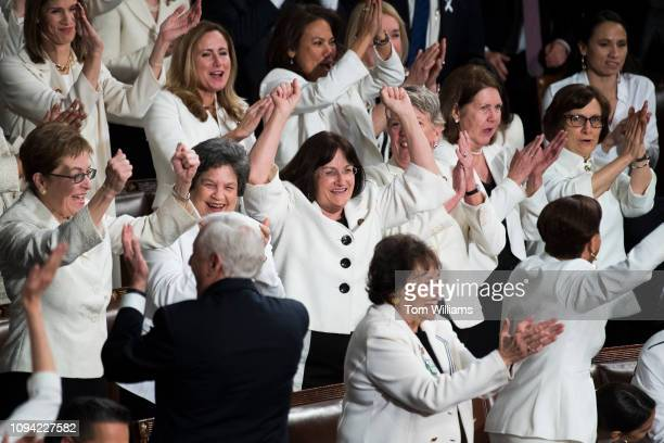 Rep Ann McLane Kuster DNH center and Democratic members celebrate in the House Chamber as President Donald Trump recognized their achievement of...