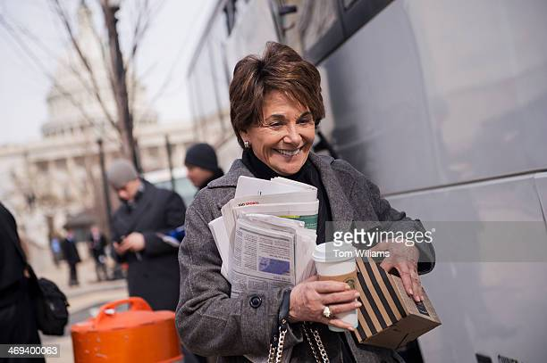 Rep Anna Eshoo DCalif prepares to board a bus at the Rayburn Horseshoe for the House Democrats' retreat in Cambridge Md