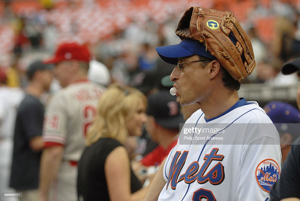 Rep. Anthony Weiner, D-Ny, blows bubblegum as he waits for the start of this years game, last year Weiner went 0-2.
