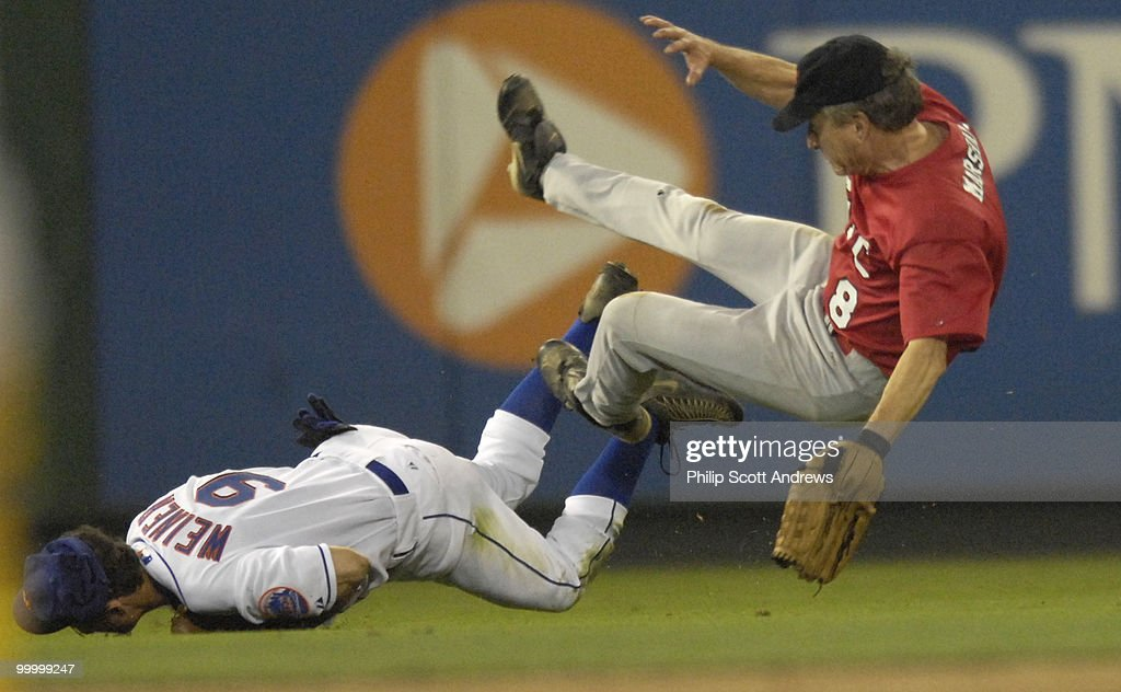 Rep. Anthony Weiner, D-Ny, collides with Rep. Jim Marshall, D-Ga, while attempting to make a play in the outfield.