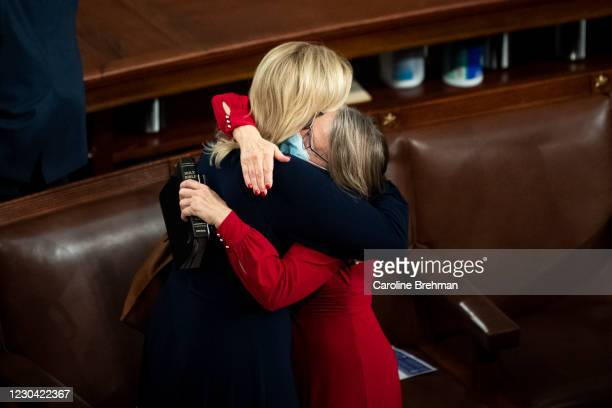 January 3: Rep. Ashley Hinson, R-Iowa, left, hugs Rep. Mariannette Miller-Meeks, R-Iowa, to celebrate getting sworn in during the first session of...