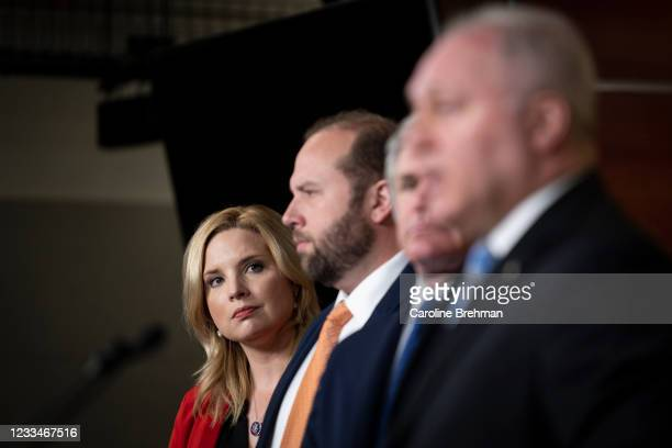 June 15: Rep. Ashley Hinson, R-Iowa, watches House Minority Whip Steve Scalise, R-La., speak during a news conference following the House Republicans...