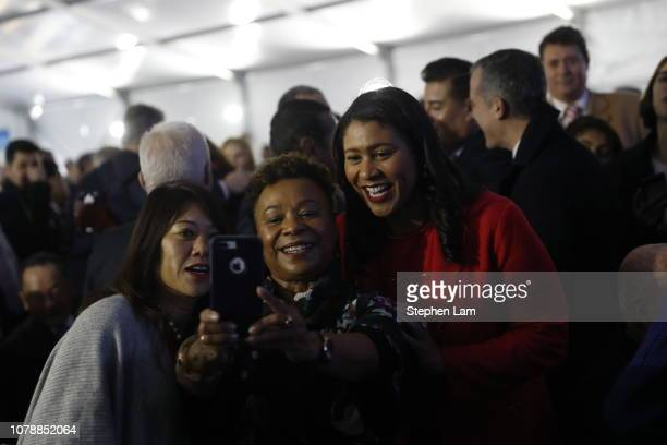Rep Barbara Lee and San Francisco Mayor London Breed pose for a selfie during the inauguration of Gavin Newsom as governor of California on January 7...