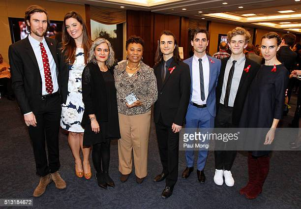 Rep Barbara Lee poses for a photo with Elizabeth Taylor's family members Tarquin Wilding Eliza Carson Laela Wilding Rhys Tivey Quinn Tivey Finn...