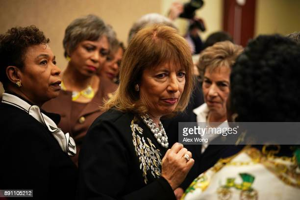 US Rep Barbara Lee Rep Brenda Lawrence Rep Jackie Speier and Rep Jan Schakowsky discuss after a news conference December 12 2017 on Capitol Hill in...