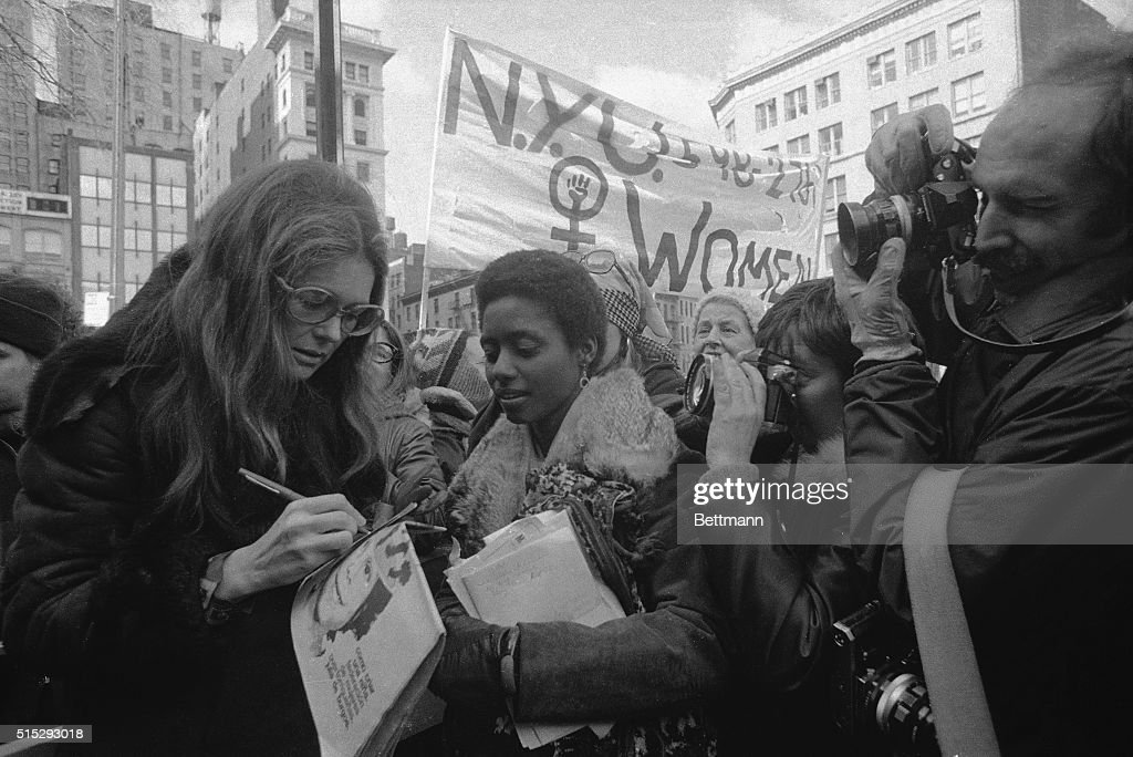 Rep. Bella Abzug, (D-N.Y.), feminist Gloria Steinem and Lt. Gov. Maryann Krupsak of New York (L-R) chat with the marchers and newsmen in midtown Manhattan prior to the start of the International Women's Day March. Some 2,000 women from all walks of life joined the solidarity march in which they demanded full economic political, legal, sexual and racial equality and the right to control their own lives and bodies.