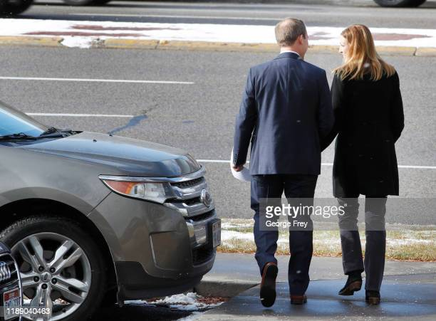 Rep Ben McAdams and his wife Julie walk to their car after the congressman announced he will vote yes on both articles of Impeachment of President...